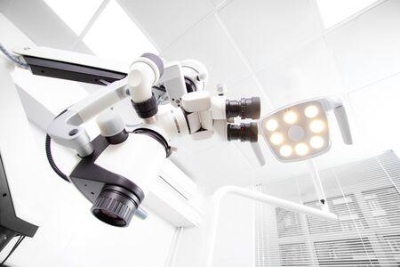 Image of a professional dental endodontic binocular microscope Фото со стока