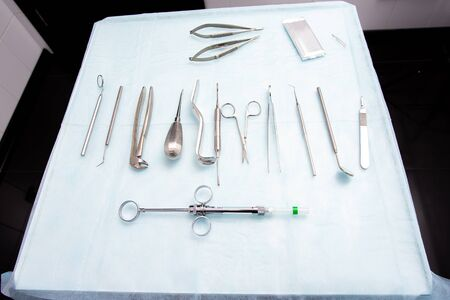 Dental tools on a sterile table. Surgical Instruments Surgery A Dentistry Concept