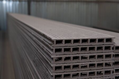 A plastic deck board is in stock. Production, warehouse Фото со стока