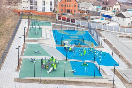 Empty children's playground, top view. The lack of children on the site. Quarantine Фото со стока
