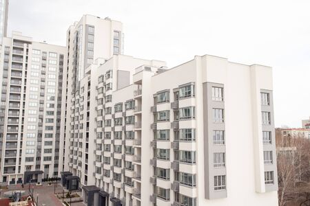 Empty multi-storey modern residential building. yard without people
