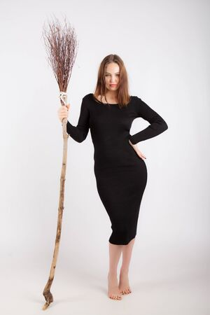 full length sexy young woman with broom