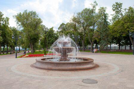 active granite fountain in a city park