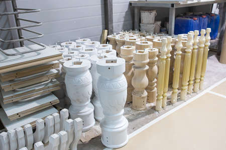 Painted wooden table legs. Beautiful professionally made one-piece beech leg in the production process in the workshop. Furniture manufacturing.
