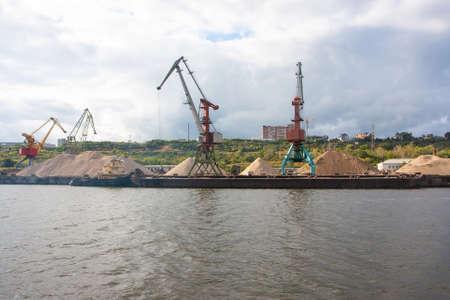 River port cranes in cargo port loading bulk materials