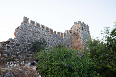 old fortress wall, watchtower. Bottom view. Ruins