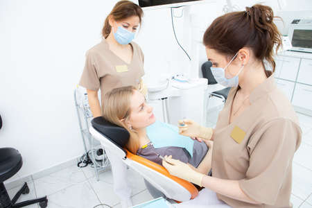 pregnant woman at the dentists office, checkup and dental treatment for pregnant women.