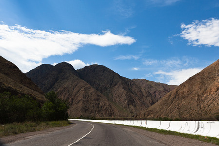kirgizia: Mountain road pass through the gorge in Asia Stock Photo