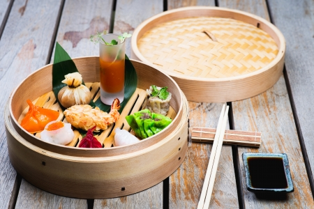 Dimsum Hagao in chinese bamboo basket. Gyoza on a wooden table in a restaurant photo
