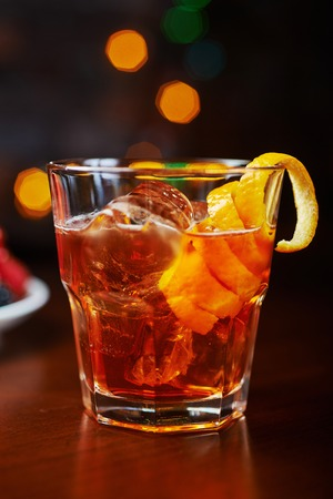alcohol screwdriver: glass of delicious alcoholic cocktails or lemonade with ice, decoration of fresh berries on a wooden table in a bar or restaurant with a beautiful bokeh in the background. soft focus.