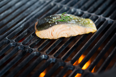 gridiron: stages of cooking salmon on the grill - fresh fillet on gridiron