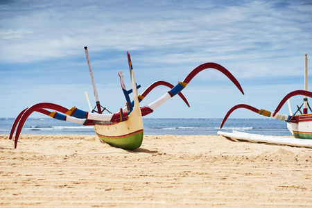 nusa: Traditional fishing boat on a sandy beach on the island of Bali in Nusa Dua.