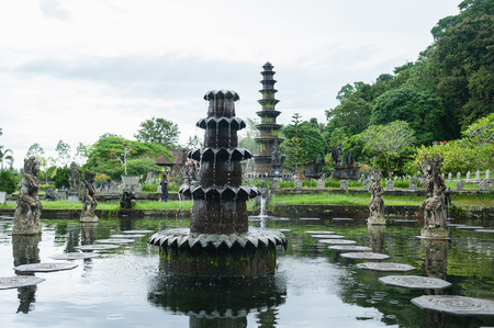 bali: Attraction in Bali Water Palace Tirta Ganga in Karangasem kingdom surrounded by palm trees and tropical landscape. Stock Photo