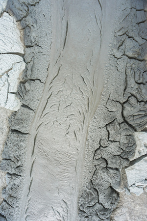volcano slope: Landscape in the area Qobustan national park in Azerbaijan. Dried and cracked mud from the mud volcano on its slope.