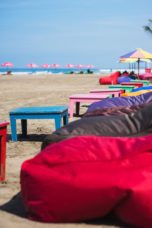 cushioned: morning tropical landscape: empty cushioned chairs and loungers on the beach