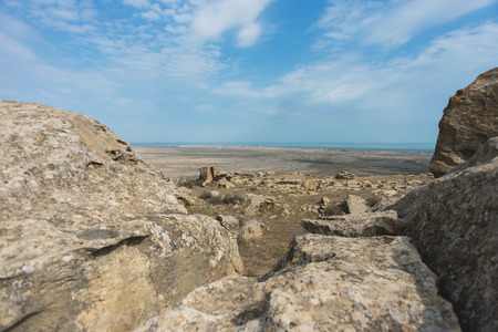 documented: Desert landscape with views of the Absheron peninsula near the national park Gobustan in Azerbaijan. Documented site of ancient people in the list of UNESCO World Heritage sites.