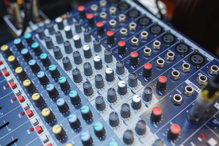 Sound equipment for connecting acoustic systems and microphones during the concerts or events. Equipment for DJ and musicians sound mixer.