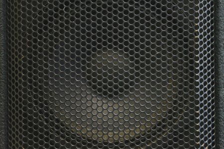 metal grate: Modern acoustic systems. Metal grating on the sound dynamics. Abstraction and background. Soft focus and beautiful light.