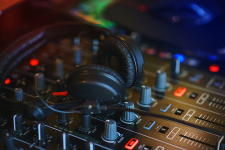 audio mixer: DJ mixer in bright colors disco in a nightclub. Audio equipment musician in a restaurant or cafe - a mixer for sound effects and music playback.