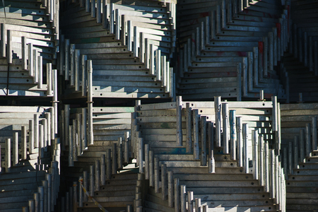 Metal Structures In A Warehouse In Stacks. Metal Supports For Scaffolding  And Formwork. Soft