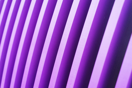 Bright stylish abstract background of wooden boards painted in bright violet color. Alternation of purple and white bands. Natural background. Soft focus and shallow depth of field.