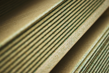 Several sheets of new clean, waterproof plywood in a stack. Sale of goods for repair and decoration. Wood and texture. Abstract background and shallow depth of field.