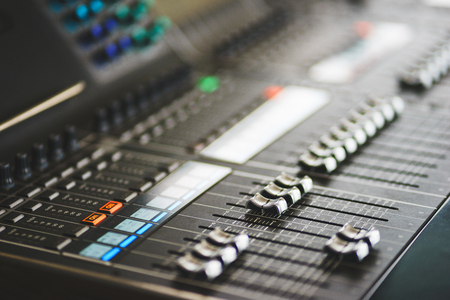Sound equipment, large mixing console for sound producer. Performance and sound design of events, holidays and parties. Modern technical equipment. Sound amplifier. Soft focus and beautiful bokeh.