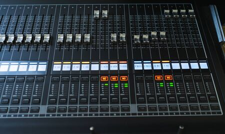 Sound equipment, large mixing console for sound producer. Performance and sound design events and parties. Modern technical equipment. Sound amplifier. Soft focus beautiful bokeh.
