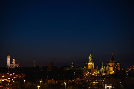 The capital of Russia is Moscow, night shooting. Evening panorama of the modern city. Red Square and the embankment of the Moscow River. Beautiful decorations and street lighting. City landscape.