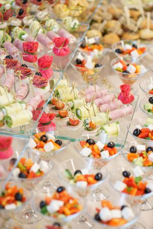 Catering and guest meals during the event. Quick mini snacks in a special beautiful dish. Canapes and light meals, tapas on the table in the restaurant.