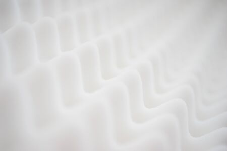 White gradient abstract background many waves different angles. Extremely soft focus blur foreground and background. Soundproof sound absorbing materials. Biological style, modern technology, bionics.