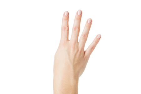 Top view: female hand with clean healthy skin on a white isolated background showing gestures with the fingers. Soft focus, shallow depth of field. Countdown - Four.