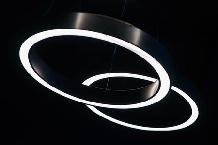 Black design and details of the modern device ceilings in the room. Lighting design, lamps and fixtures. Lighting devices. Details of the modern interior. 版權商用圖片
