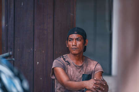 KUTA, BALI, INDONESIA-APRIL, 2020: Indonesians locals and street market employees sell souvenirs, cheap clothes, and food. Environment and society. Poverty and cheap goods. Travel to Asia.