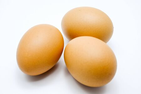 protein crops: Three eggs isolated on white background Stock Photo