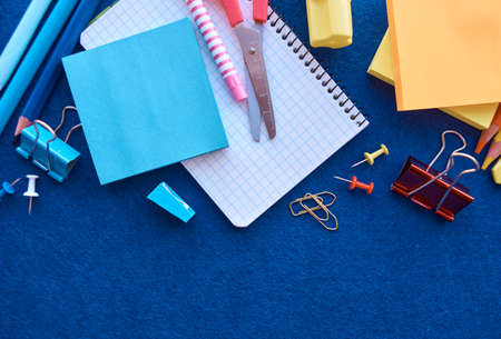 Stationery set on blue background. School supplies top view for advertising and promotional items. Back to school concept