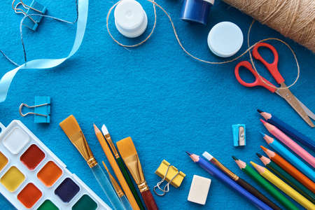 Art materials, products for drawing. Stationery set on blue background Reklamní fotografie