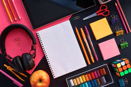 Study from home. Online education.School supplies top view for advertising and promotional items. Back to school concept. Stationery set on black background. Reklamní fotografie