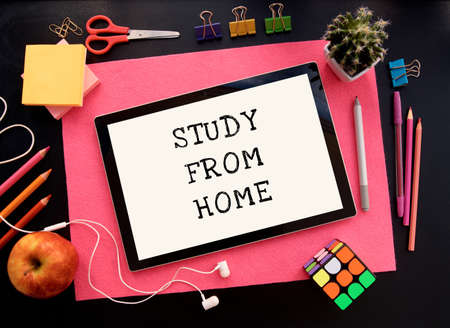 Kiev, Ukraine - July 03, 2020. Study from home. Online education.School supplies top view for advertising and promotional items. Back to school concept. Stationery set on black background.