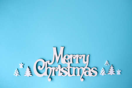Merry Christmas greeting card. Blue color background with lettering.