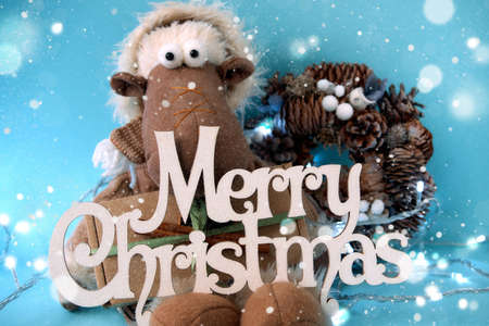 Merry Christmas and Happy New Year greeting card. Xmas holiday background with a Christmas toy