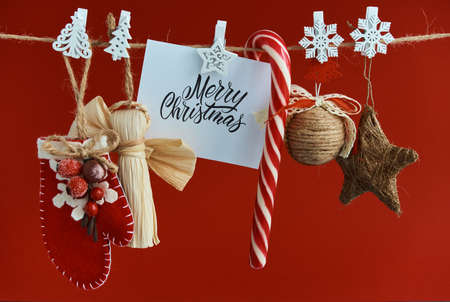 Merry Christmas greeting card. Christmas background with festive decoration and text Stock fotó