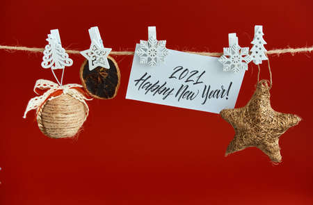 Happy New Year greeting card. Xmas background with festive decoration and text