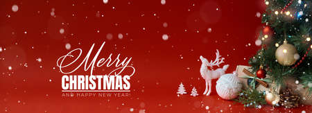 Merry Christmas and Happy New Year greeting card. Panoramic Christmas background with festive decoration and text