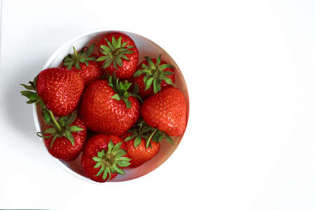 Strawberries on white background. Berries in a plate