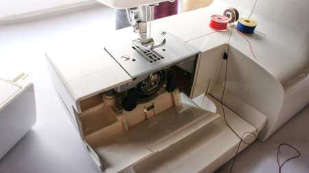 electric sewing machine with thread and bobbin
