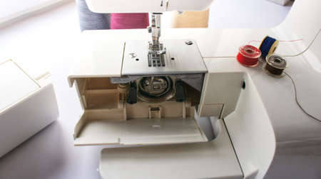 electric sewing machine with thread and bobbin Reklamní fotografie - 166956143