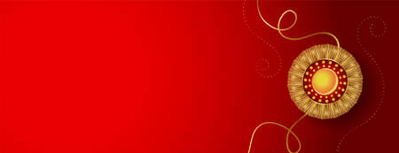 red banner with golden rakhi and text space