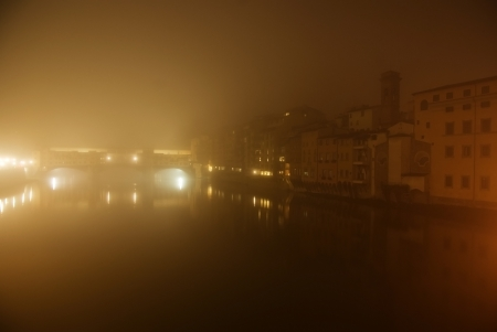 old bridge florence Italy at night in the fog