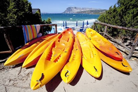 sardinia canoes on the beach